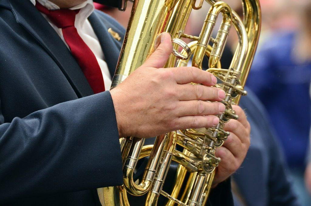 man playing tuba musical instrument